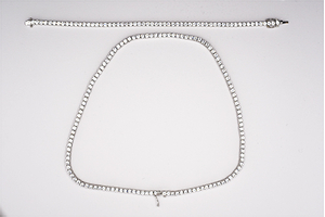 9 carat white gold cubic zirconia tennis and collar set