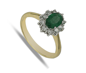 Eighteen carat yellow and white gold oval emerald and diamond cluster ring