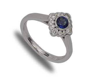 18 carat white gold sapphire and diamond cluster ring