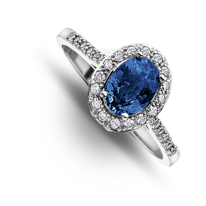 Nine carat white gold oval sapphire and diamond cluster ring